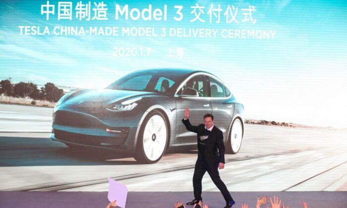 Tesla CEO Elon Musk gestures during the Tesla China-made Model 3 Delivery Ceremony in Shanghai in this undated photo. (STR/AFP via Getty Images)