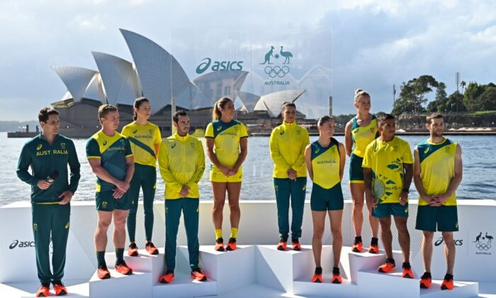 From L-R: Australian athletes AJ Roach, Henry Hutchinson, Marina Carrier, Jake Birtwhistle, Charlotte Caslick, Lisa Darmanin, Katie Ebzer, Lucy Stephan, Maurice Longbottom and Tom O'Halloran pose during the unveiling of the ASICS Australian Olympic Team competition uniforms for the Tokyo 2020 Games in front of the Sydney Opera House on March 31, 2021. (Steven Saphore/ Getty Images)