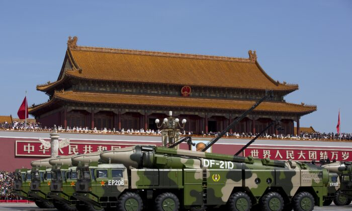 Chinese military vehicles carrying DF-21D anti-ship ballistic missiles, potentially capable of sinking a U.S. Nimitz-class aircraft carrier in a single strike, drive past the Tiananmen Gate during a military parade in Beijing, China, on Sept. 3, 2015. (Andy Wong/Getty Images)