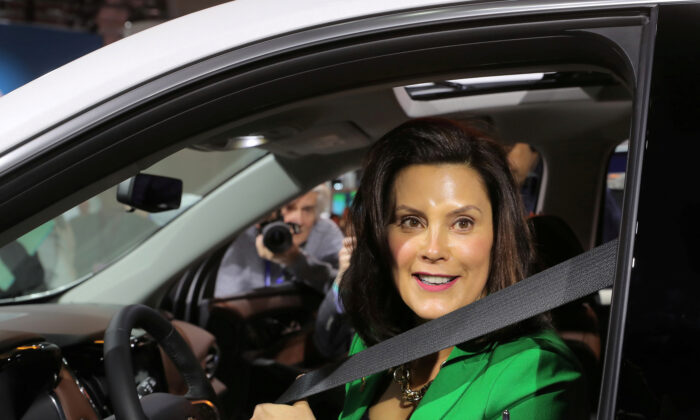 Michigan Gov. Gretchen Whitmer sits in a 2019 Chevrolet Traverse, assembled in Lansing, Michigan, at the General Motors display area during the North American International Auto Show in Detroit, Mich., on Jan. 15, 2019. (Rebecca Cook/Reuters File Photo)