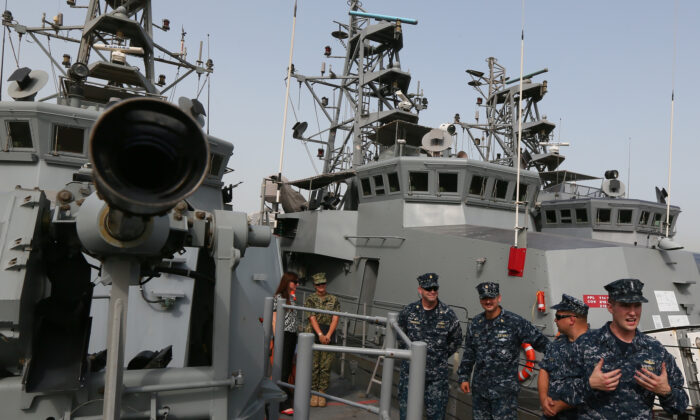 U.S. Navy soldiers speak to press on deck of USS Firebolt at Salman port in the capital Manama, Bahrain, on May 12, 2013. (Marwan Naamani/AFP via Getty Images)