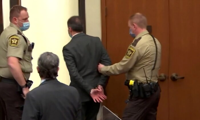 Former Minneapolis police officer Derek Chauvin is led away in handcuffs past his defense attorney Eric Nelson after a jury found him guilty of all charges in his trial for second-degree murder, third-degree murder, and second-degree manslaughter in the death of George Floyd in Minneapolis, on April 20, 2021. (Screenshot /Pool via Reuters)