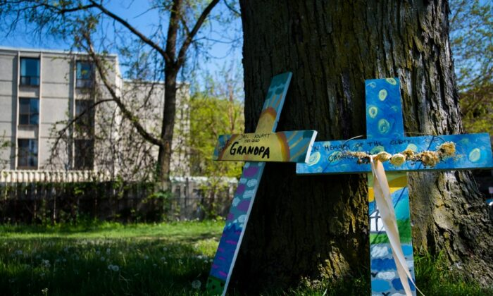 Crosses are displayed outside the Camilla Care Community centre marking the deaths of multiple people that occurred during the COVID-19 pandemic in Mississauga, Ont., on May 26, 2020. (Nathan Denette/The Canadian Press)