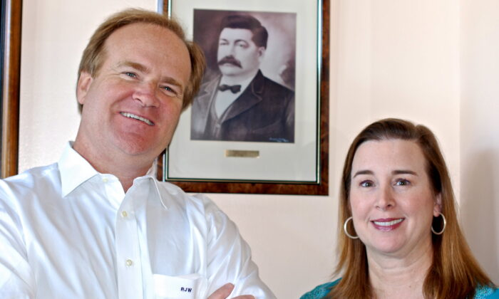 Robert J. Whann IV, known as Sandy, and Katherine Whann, fourth-generation members of the family, run the business today. Behind them is a framed photo of George Leidenheimer. (Photograph taken by the Southern Foodways Alliance)