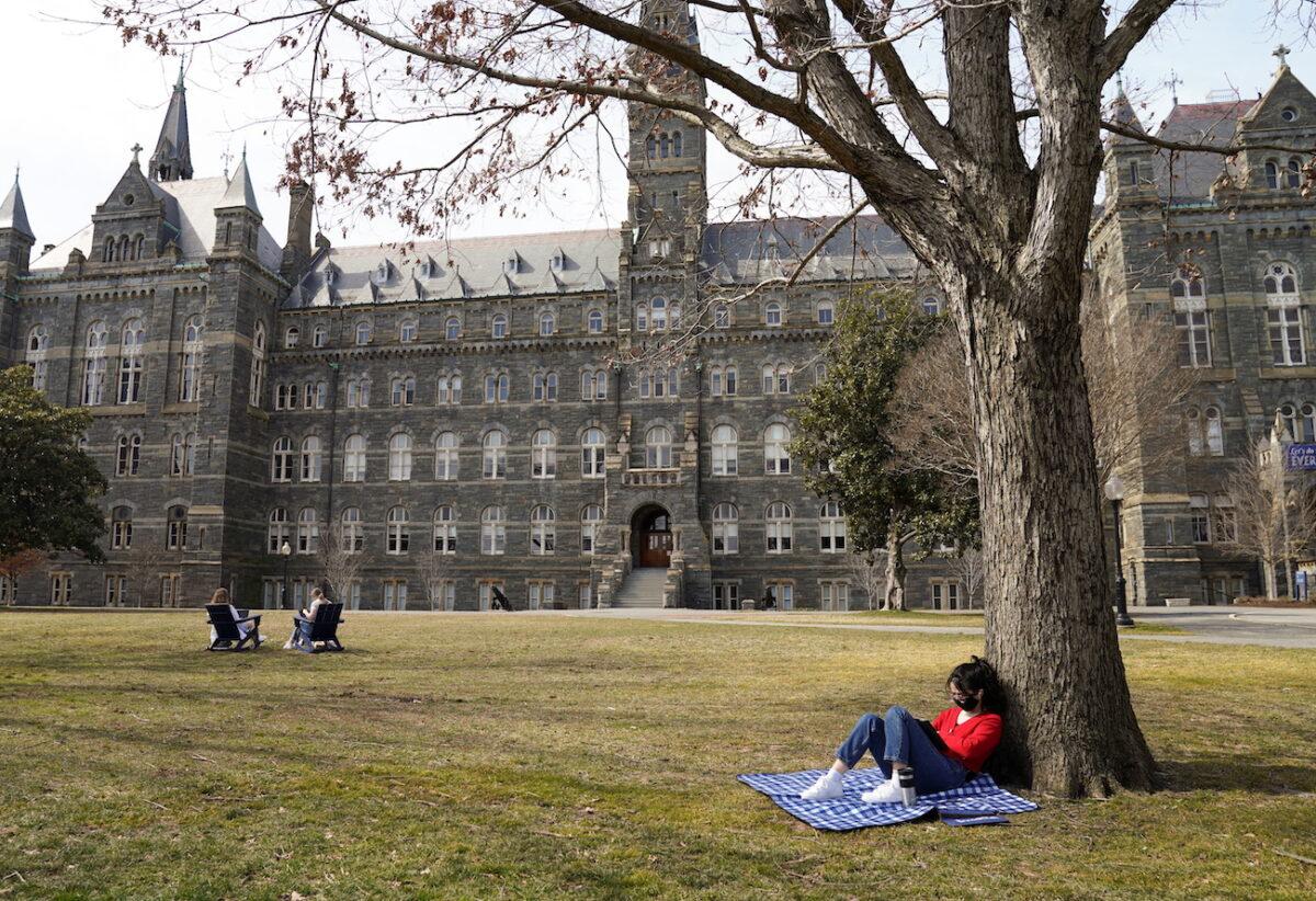 Georgetown University students take advantage of the warm sunshine in Washington