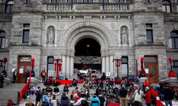 Wet'suwet'en supporters and Coastal GasLink opponents continue to protest outside the B.C. Legislature in Victoria, B.C., on February 27, 2020. (Chad Hipolito/The Canadian Press)