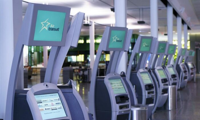 Air Transat self service check-in kiosks are seen at Montreal-Trudeau International Airport in Montreal, on Friday, July 31, 2020. (The Canadian Press/Paul Chiasson)