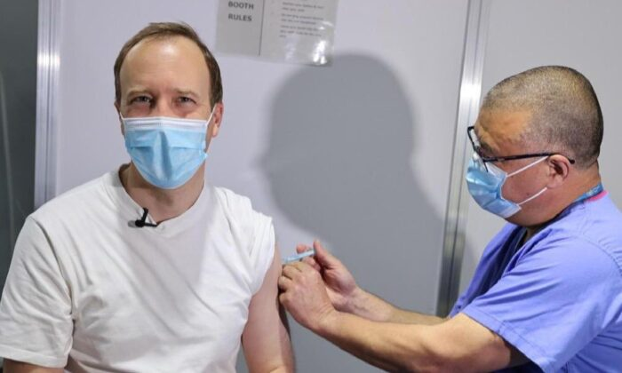 Jonathan Van-Tam, the Deputy Chief Medical Officer for England, administers a dose of the Oxford/AstraZeneca COVID-19 vaccine to UK Health Secretary Matt Hancock at a vaccination centre in London, on April 29, 2021. (UK government)
