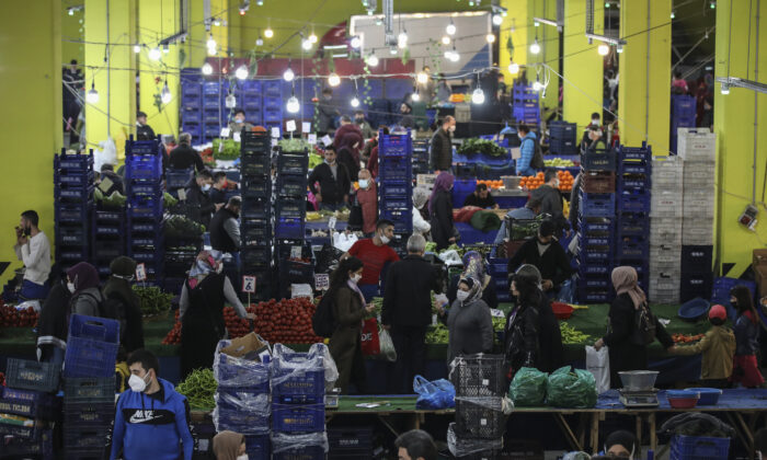People shop at the local market in Istanbul a few hours before the start of the latest lockdown to help protect from the spread of the coronavirus, on April 29, 2021. (AP Photo/Emrah Gurel)