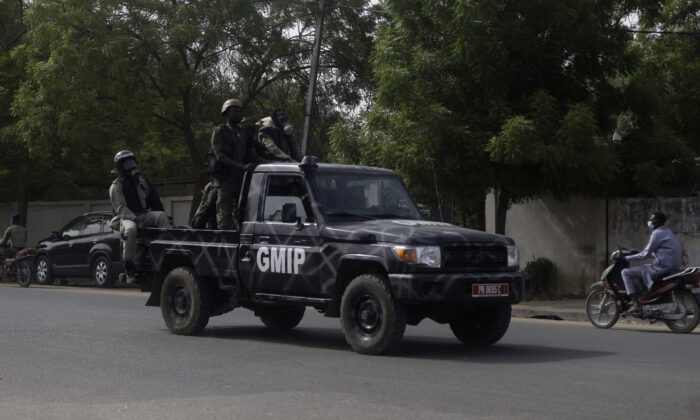 Police officers patrol the street following a protest in N'Djamena, Chad, on April 27, 2021. (Sunday Alamba/ AP Photo)