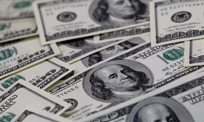U.S. one hundred dollar notes are seen in this picture illustration taken in Seoul on Feb. 7, 2011. (Lee Jae-Won/Reuters)