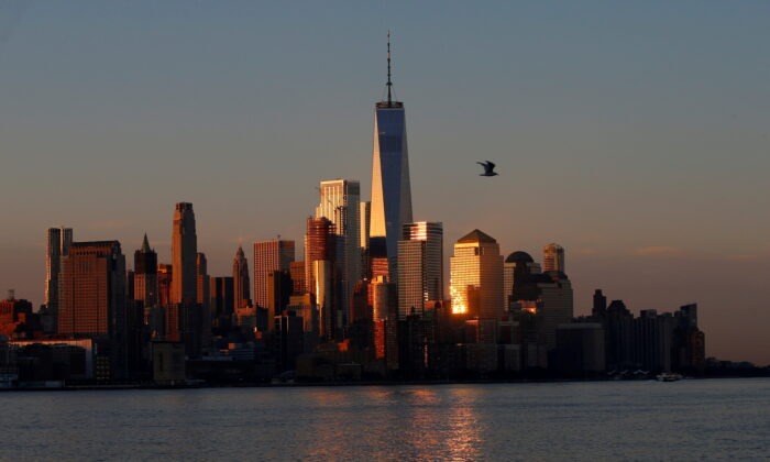 A view of the One World Trade Centre tower and the lower Manhattan skyline of New York City at sunrise as seen from Hoboken, N.J., on Aug. 9, 2017. (Mike Segar/Reuters)