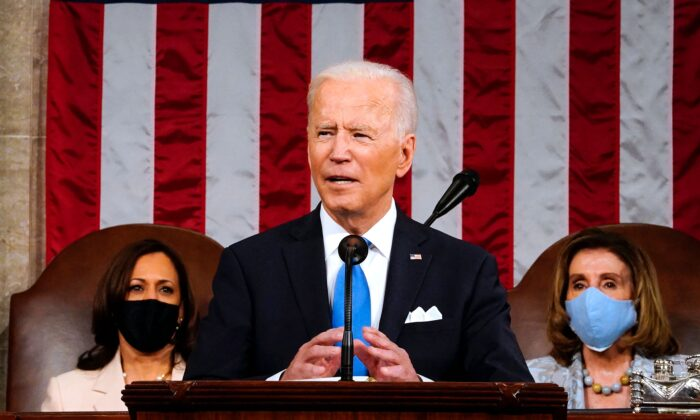 President Joe Biden, flanked by Vice President Kamala Harris (L) and Speaker of the House of Representatives Nancy Pelosi (R), addresses a joint session of Congress at the US Capitol in Washington, on April 28, 2021. (Melina Mara/Pool/AFP via Getty Images)