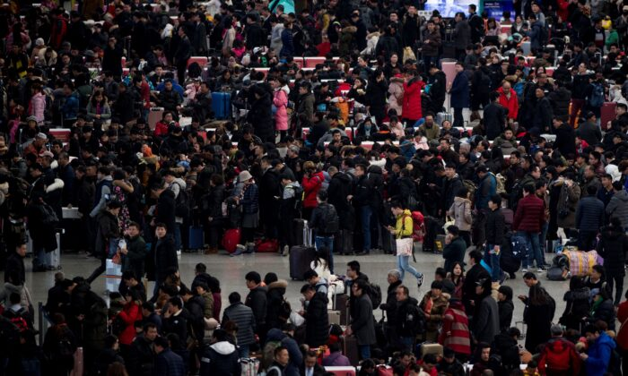 Passengers gather in the waiting hall at Hongqiao Railway Station ahead of the Lunar New Year holidays in Shanghai, China, on Feb. 6, 2018.