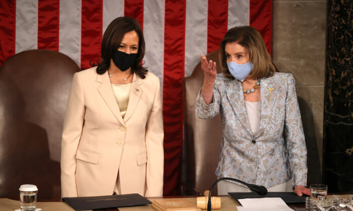 Vice President Kamala Harris and Speaker of the House Nancy Pelosi (D-Calif.) speak after President Joe Biden addressed a joint session of congress in the House chamber of the U.S. Capitol, in Washington, on April 28, 2021. (Chip Somodevilla/Getty Images)