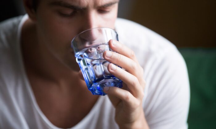 Water boosts immunity, lubricates joints, and helps your body keep a balance of electrolytes.(fizkes/Shutterstock)