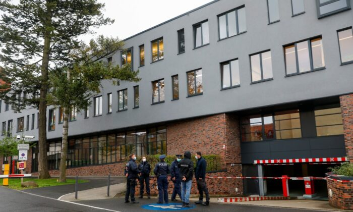 Police officers stand near the Oberlin Clinic, where four people were found dead and another seriously injured, following the arrest of a 51-year-old-woman in Potsdam, Germany, on April 29, 2021. (Michele Tantussi/Reuters)