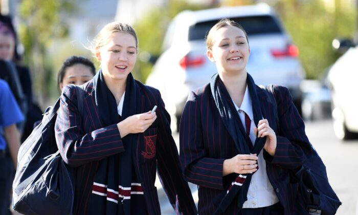 School students arrive for the first day school in Brisbane, Australia, May 11, 2020. (AAP Image/Dan Peled)