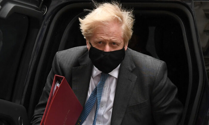 Britain's Prime Minister Boris Johnson wearing a face covering due to CCP virus pandemic, arrives back at 10 Downing Street in central London on April 28, 2021. (Daniel Leal-Olivas/AFP via Getty Images)