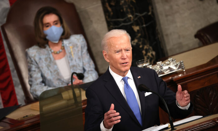 President Joe Biden addresses a joint session of congress as House Speaker Rep. Nancy Pelosi (D-Calif.) (L) looks on in the House chamber of the Capitol in Washington on April 28, 2021. (Chip Somodevilla/Getty Images)