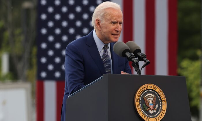 """President Joe Biden speaks during the Democratic National Committee's """"Back on Track"""" drive-in car rally to celebrate the president's 100th day in office at the Infinite Energy Center in Duluth, Ga., on April 29, 2021. (Evelyn Hockstein/Reuters)"""