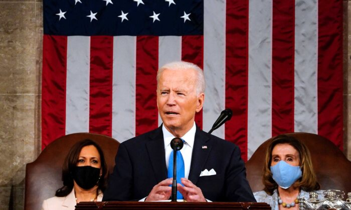 President Joe Biden, flanked by Vice President Kamala Harris, left, and House Speaker Nancy Pelosi, addresses a joint session of Congress at the Capitol in Washington on April 28, 2021. (Melina Mara/Pool/AFP via Getty Images/TNS)