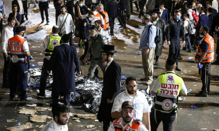 Medics and rescue workers attend to the Lag B'Omer event in Mount Meron, northern Israel, where fatalities were reported among the thousands of ultra-Orthodox Jews gathered at the tomb of a 2nd-century sage for annual commemorations that include all-night prayer and dance, at Mount Meron, Israel, on April 30, 2021. (Reuters)