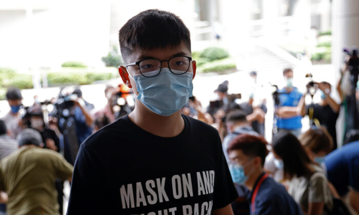 Pro-democracy activist Joshua Wong arrives at the Eastern Magistrates' Courts over illegal assembly and violation of an emergency law banning face coverings last year, in Hong Kong, China on Sept. 30, 2020. (Tyrone Siu/REUTERS)