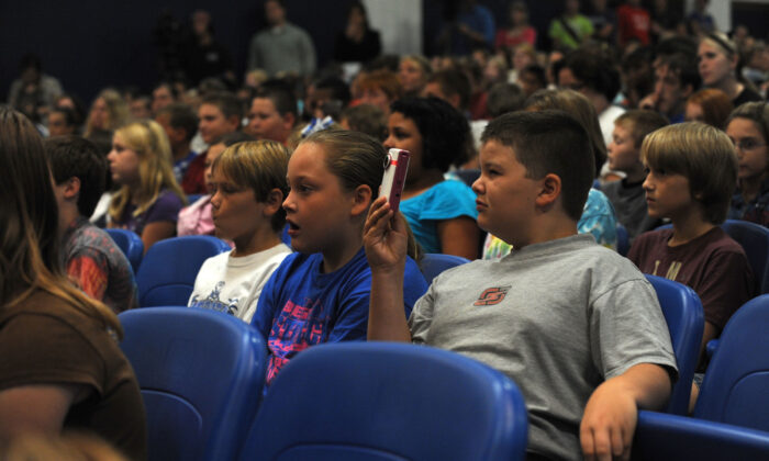 Students look on during an assembly at Checotah High School to surprise students with more than $117,000 in new music instruments, a joint gift from Underwood?s C.A.T.S. Foundation and ACM Lifting Lives in Checotah, Okla. on Aug. 28, 2009. (Rick Diamond/Getty Images for ACM)