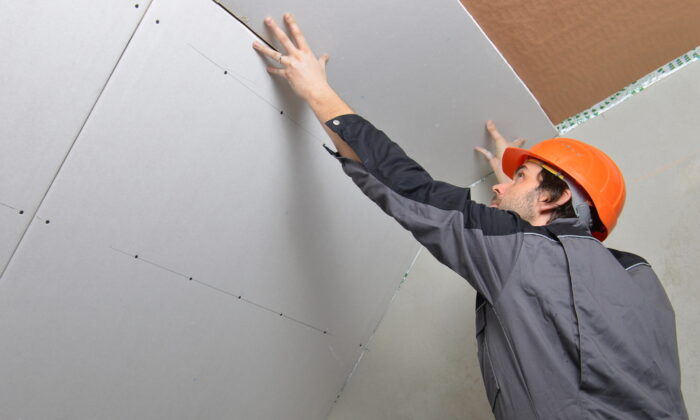Hanging drywall is not as difficult as most people think it is. (Visionsi/Shutterstock)