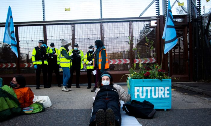 An all-female group of protesters who have blocked the North Gate of the Faslane Naval Base in Gare Loch, near Helensburgh, as part of the International Peace Lotus Campaign, on April 30, 2021. (XR Scotland via PA)