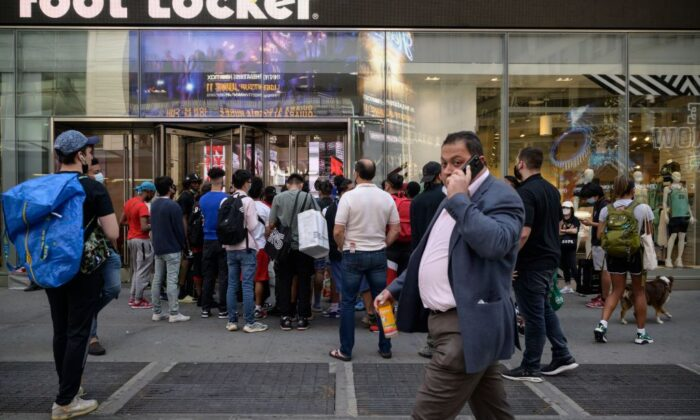 Shoppers queue outside a show store in New York city on May 19, 2021. ED JONES/AFP via Getty Images