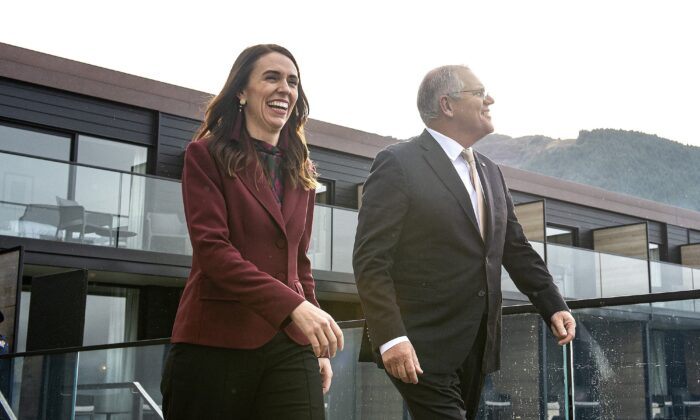 New Zealand's Prime Minister Jacinda Ardern (L) walks onto a balcony at the Nest with Australia's Prime Minister Scott Morrison ahead of the Australia-New Zealand Leaders' Meeting in Queenstown on May 31, 2021. (Joe Allison / Pool / AFP via Getty Images)