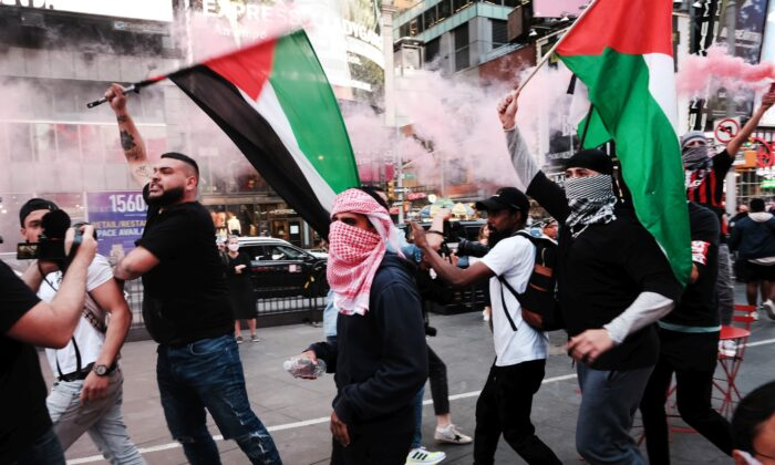Pro-Palestinian protesters march in the streets during a violent clash with Israel supporters and police in Times Square in New York City on May 20, 2021. (Spencer Platt/Getty Images)