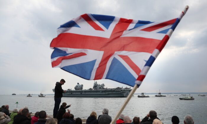 The Royal Navy aircraft carrier HMS Queen Elizabeth leaves Portsmouth Naval Base in Hampshire for exercises off Scotland before heading to the Indo-Pacific region, on May 1, 2021. (PA)