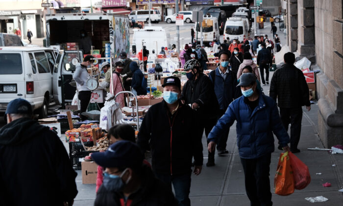 People walk through the streets of Chinatown in New York City, on March 23, 2021. (Spencer Platt/Getty Images)