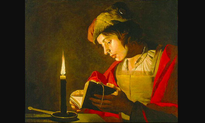 """""""Young Man Reading by Candlelight,"""" 1628–1632, by Matthias Stom. (Public domain)"""