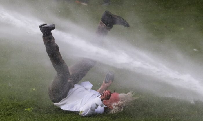 Belgium anti-lockdown protest water cannon