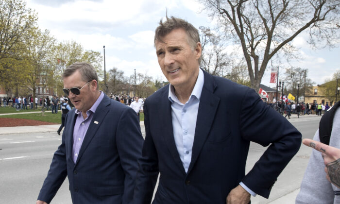 People's Party of Canada Leader Maxime Bernier leaves a protest against COVID-19 restrictions in Peterborough, Ont., on April 24, 2021. (The Canadian Press/Fred Thornhill)