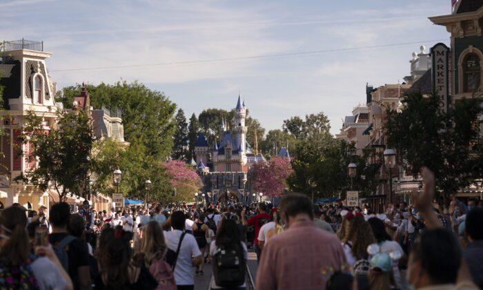 Guests walk along the Main Street USA at Disneyland in Anaheim, Calif., on April 30, 2021. (Jae C. Hong/AP Photo)