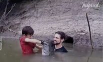 Father Teaches His Son How to Catch Fish by Hand