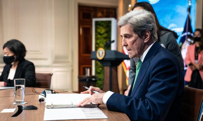John Kerry, the Special Presidential Envoy for Climate, looks at his notes before the start of the virtual Leaders Summit on Climate in the East Room of the White House on April 23, 2021. (Anna Moneymaker-Pool/Getty Images)