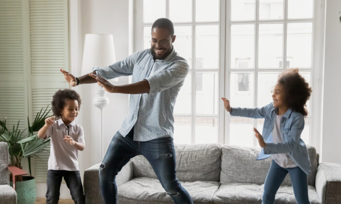 When pressure mounts and the kids need to let off steam, it's time for ... a dance break. (fizkes/Shutterstock)