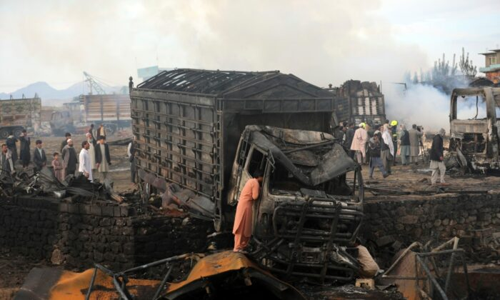 A driver views the damage of his truck caught in a fire in Kabul, Afghanistan, on May 2, 2021. (Rahmat Gul/AP Photo)