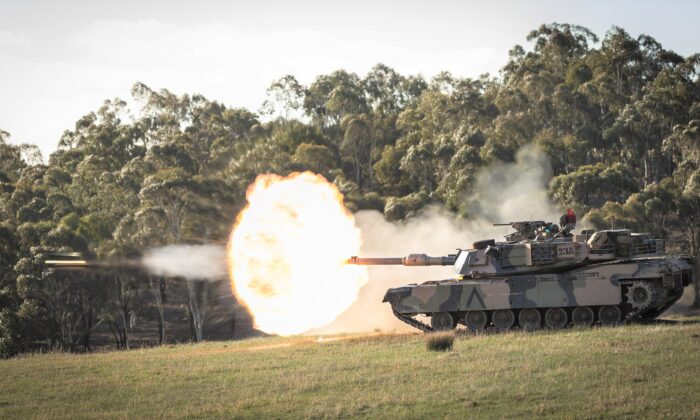 A supplied photograph of an Australian Army M1A1 Abrams tank firing at targets during Exercise Chong Ju at Puckapunyal training area, Victoria, Australia on May 17, 2018.  (AAP Image/Supplied by Australian Department of Defence)