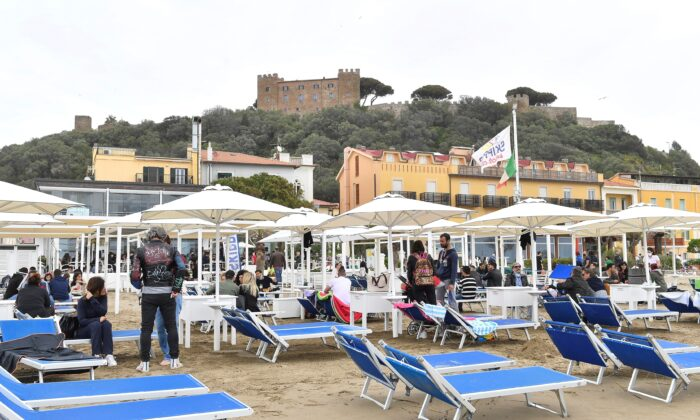 People enjoy a Sunday at the beach as COVID-19 restrictions ease around the country, in Castiglione della Pescaia, Italy, on May 2, 2021. (Jennifer Lorenzini/Reuters)