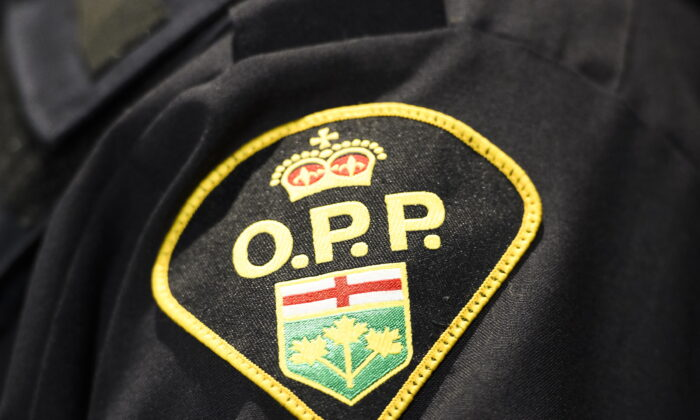 An Ontario Provincial Police logo is shown during a press conference in Barrie, Ont., Canada, on April 3, 2019. (Nathan Denette/The Canadian Press)