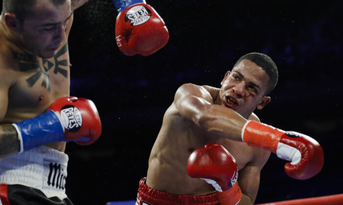 Puerto Rico's Felix Verdejo (R) punches Costa Rica's Bryan Vazquez during the fifth round of a lightweight boxing match in New York, on April 20, 2019. (Frank Franklin II/AP Photo)