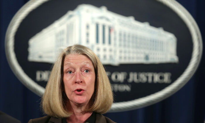 Acting Assistant Attorney General Mary McCord speaks during a news conference at the Justice Department on March 15, 2017. (Alex Wong/Getty Images)