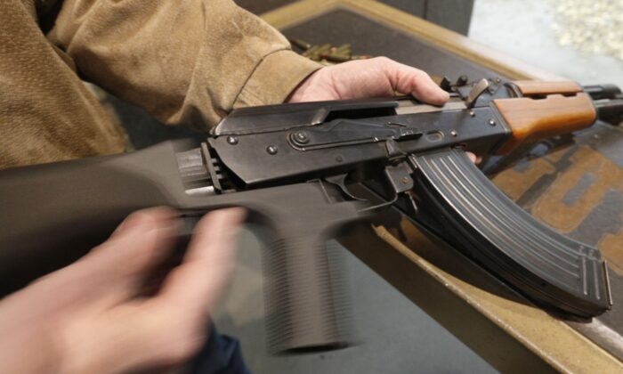 A bump stock is installed on an AK-47 and its movement is demonstrated at Good Guys Gun and Range in Orem, Utah on Feb. 21, 2018. (George Frey/Getty Images)